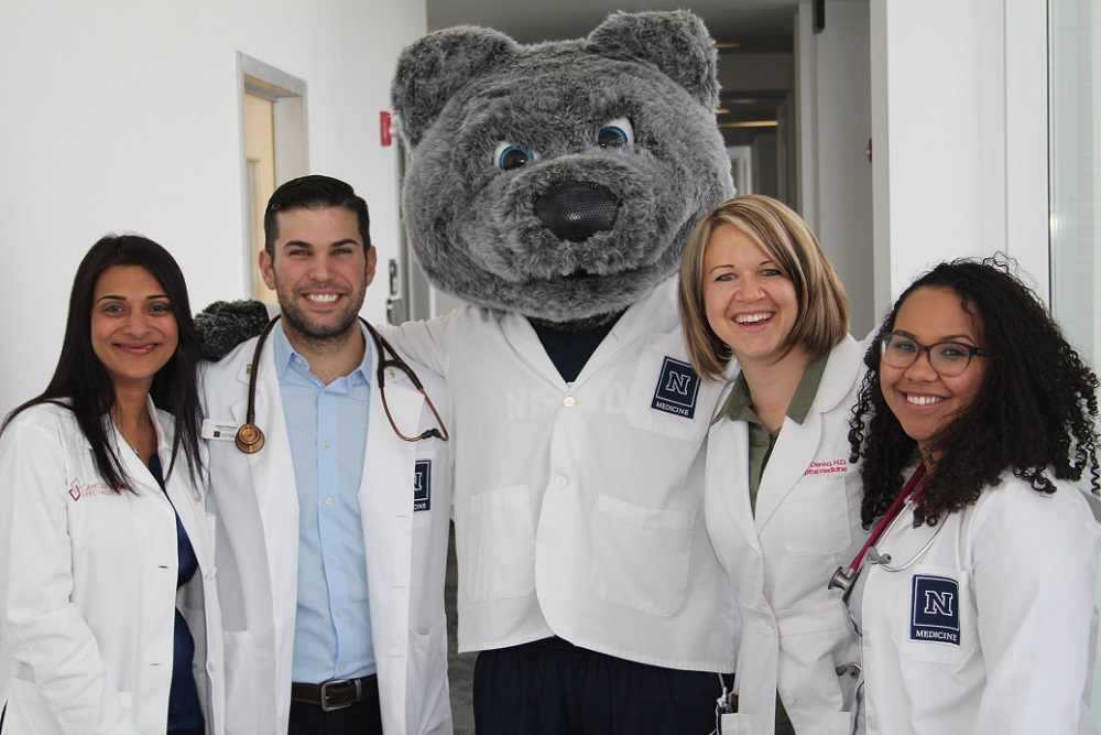 Students and Community faculty members with Wolfie.