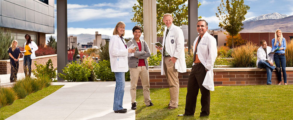 students and faculty in medical coats