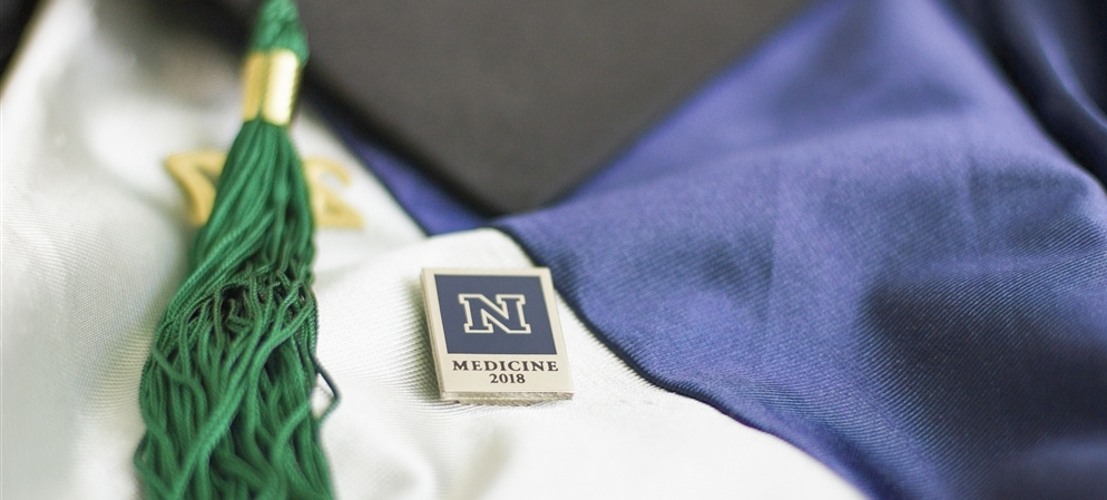 School of Medicine pin and graduation tassel.