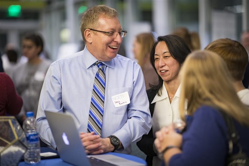 Dean Burkin, Ph.D., UNR Med professor of pharmacology and director of the CMPP Graduate Program, and Takako Jones, Ph.D., research associate professor, discuss their work with visitors during NCET Tech Wednesday on Nov. 14. (Photo by Brin Reynolds/UNR Med)