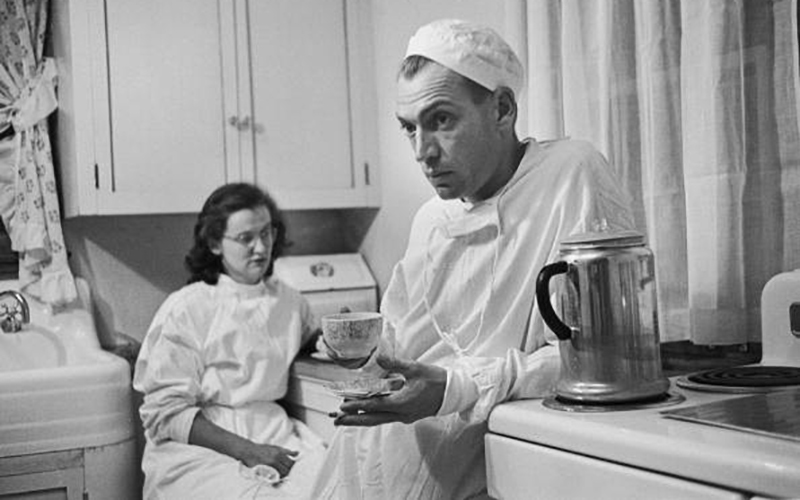 Dr. Ernest Ceriani and nurse Margaret Neiberger rest in the hospital kitchen at 2 a.m. following a long surgery.