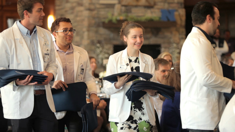 UNR Med students presented gifts to volunteer community faculty.