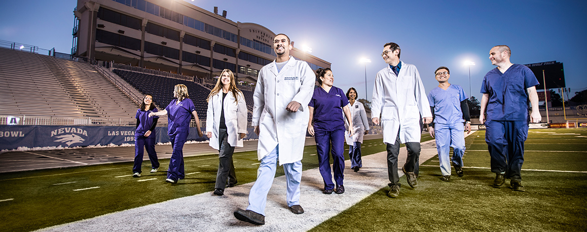Med Students Walking on the football field